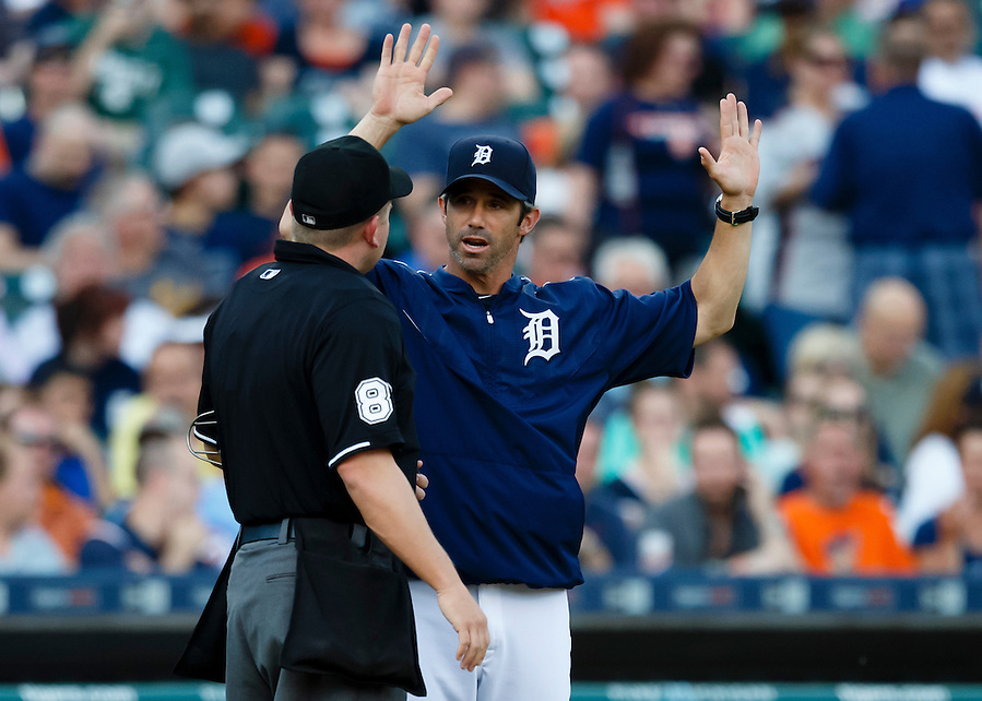 Jun 10, 2015; Detroit, MI, USA; Detroit Tigers manager Brad Ausmus (7) talks to umpires Clint Fagan in the second inning against the Chicago Cubs at Comerica Park. Mandatory Credit: Rick Osentoski-USA TODAY Sports (Rick Osentoski/Rick Osentoski-USA TODAY Sports)