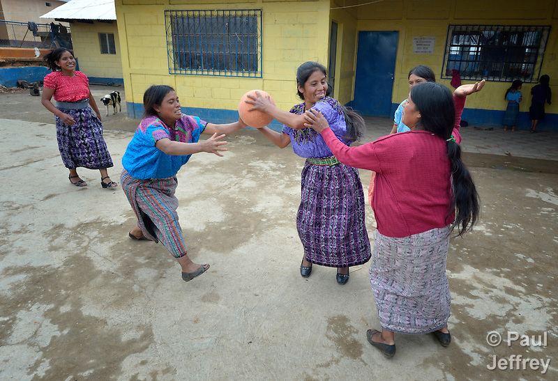 Maria Valentina Lopez holds the ball as indigenous women play basketball in Tuixcajchis, a small Mam-speaking Maya village in Comitancillo, Guatemala. (Paul Jeffrey)