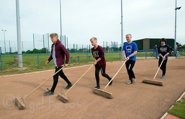 17 MAY 2015 - IPSWICH, GBR - Pierce Bacon (left), Harrison Bacon (second from left), Fraser Harris (second from right) and Lewis Roberts (right) of Ipswich Eagles sweep out piles of shale on the track after the Elite League cycle speedway fixture between Ipswich Eagles and Horspath Hammers at Whitton Sports and Community Centre in Ipswich, Suffolk, Great Britain (PHOTO COPYRIGHT © 2015 NIGEL FARROW, ALL RIGHTS RESERVED) (NIGEL FARROW/COPYRIGHT © 2015 NIGEL FARROW : www.nigelfarrow.com)