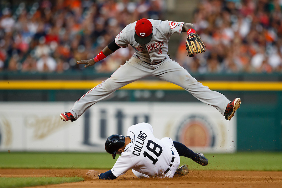 Jun 16, 2015; Detroit, MI, USA; Cincinnati Reds second baseman Brandon Phillips (4) leaps over Detroit Tigers designated hitter Tyler Collins (18) as he slides into second after making a throw to first to complete a double play in the sixth inning at Comerica Park. Mandatory Credit: Rick Osentoski-USA TODAY Sports (Rick Osentoski/Rick Osentoski-USA TODAY Sports)