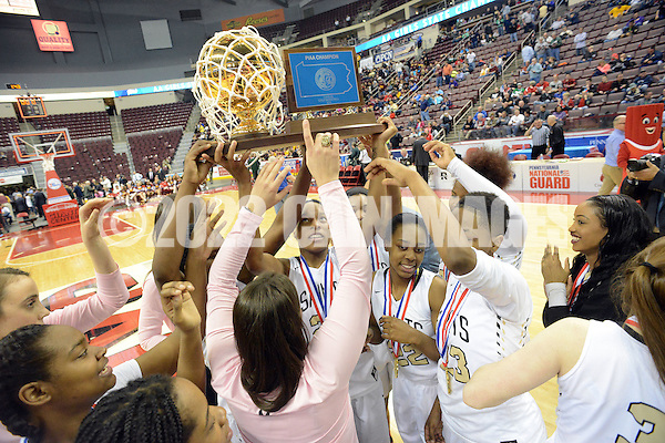 SGNEUM19P Neumann-Goretti team members hold the trophy in the air after defeating North Star to win the girls basketball PIAA Class AA state championship game Friday March 18, 2016 at the Giant Center in Hershey, Pennsylvania. (WILLIAM THOMAS CAIN/For The Inquirer) (William Thomas Cain/Cain Images)