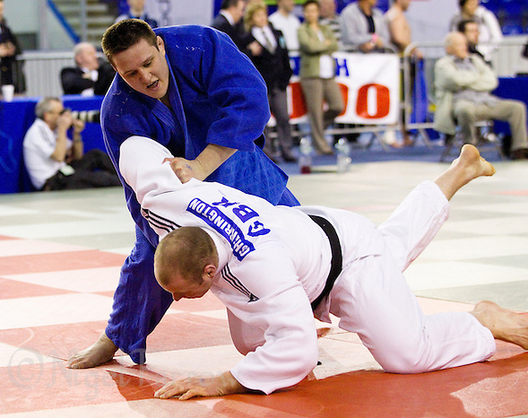 27 MAR 2011 - SHEFFIELD, GBR - Christopher Sherrington (white) v Matthew Clempner (blue) - men's over 100kg category - English Senior Open Judo Championships (PHOTO (C) NIGEL FARROW) (NIGEL FARROW/(C) 2011 NIGEL FARROW)