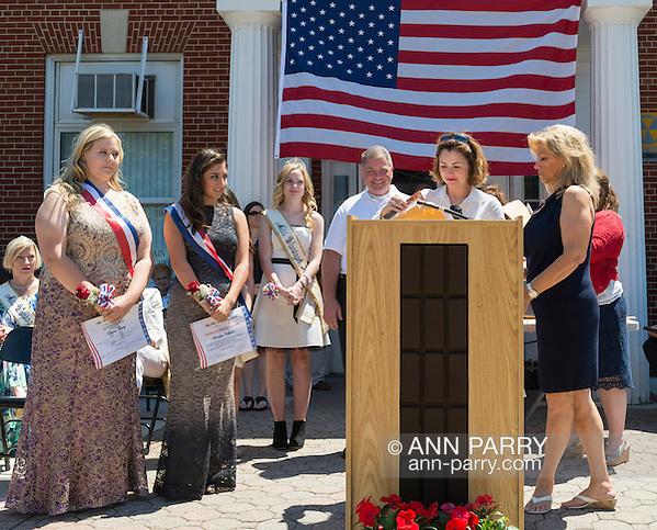 Wantagh, New York, USA. July 4, 2016. Standing L-R, EMMA CAREY; BRIANNA COLTELLINO; KERI BALNIS, Miss Wantagh 2015; STEVE RHOADS, Nassau County Legislator District 19; MAUREEN O'CONNELL, Nassau County Clerk; and ELLA STEVENS, Miss Wantagh Pageant coordinator; at the 60th Annual Miss Wantagh Pageant, an Independence Day tradition on Long Island. O'Connell is opening envelop to find who Miss Wantagh 2016 is - Emma or Brianna. Since 1956, the Miss Wantagh Pageant, which is not a beauty pageant, crowns an area high school student based mainly on academic excellence and community service. (Ann Parry/Ann Parry, ann-parry.com)