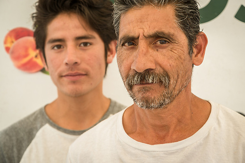 """I don't know what I want to be...but I don't think I want to sell vegetables.""  Eighteen year old Sam Ortiz sells vegetables with his uncle, Laucio, at the Calistoga Saturday Market.  Rojas Family Farms (Clark James Mishler)"