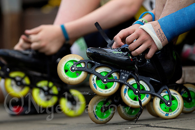 11 AUG 2013 - BIRMINGHAM, GBR - Competitors take off their inline skates after their race during the Federation of Inline Speed Skating 2013 British Outdoor Championships at Birmingham Wheels Park in Birmingham, West Midlands, Great Britain. Depending on the event some competitors will change the wheels after each race at a cost of up to £150 per set  (PHOTO COPYRIGHT © 2013 NIGEL FARROW, ALL RIGHTS RESERVED) (NIGEL FARROW/COPYRIGHT © 2013 NIGEL FARROW : www.nigelfarrow.com)
