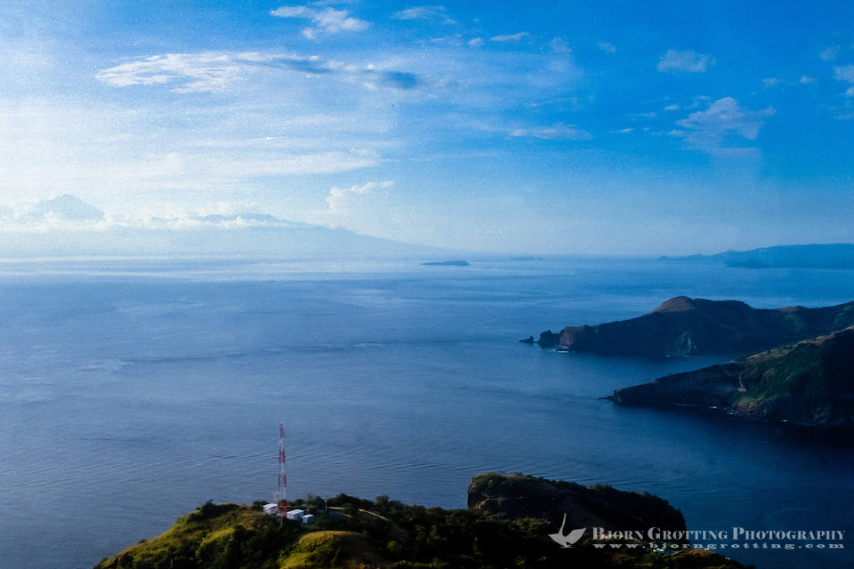 West Nusa Tenggara, Sumbawa. The west coast of Sumbawa looking west. In the background to the left you can barely see Mount Rinjani on Lombok (from helicopter). (Bjorn Grotting)