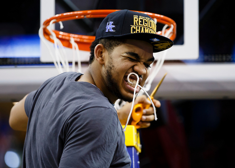 Kentucky Wildcats forward Trey Lyles (41) holds a piece of net in his teeth after the game against the Notre Dame Fighting Irish in the finals of the midwest regional of the 2015 NCAA Tournament at Quicken Loans Arena. Kentucky won 68-66. Mandatory Credit: Rick Osentoski-USA TODAY Sports (Rick Osentoski/Rick Osentoski-USA TODAY Sports)