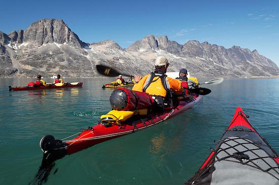 Sea kayakers paddling on Ikaasatsivaq Fjord, Ammassalik Island, East Greenland (Brad Mitchell)