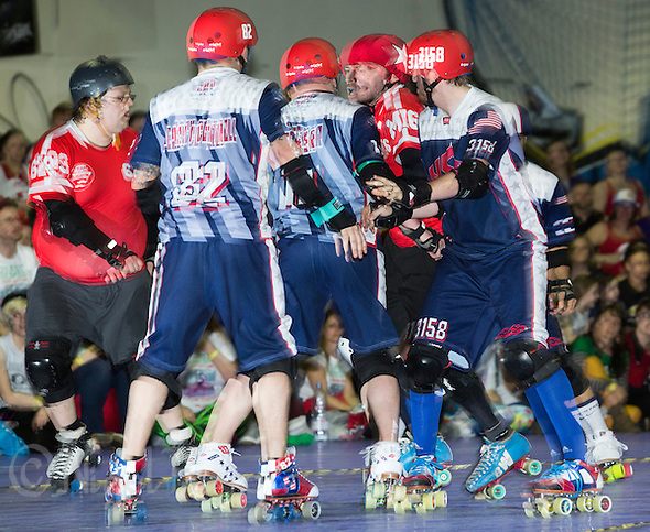 16 MAR 2014 - BIRMINGHAM, GBR - Team England jammer Ballistic Whistle (second from the right) is buffeted by Team USA blockers as he tries to score during the inaugural Men's Roller Derby World Cup final in the Futsal Arena in Birmingham, West Midlands, Great Britain (PHOTO COPYRIGHT © 2014 NIGEL FARROW, ALL RIGHTS RESERVED) (NIGEL FARROW/COPYRIGHT © 2014 NIGEL FARROW : www.nigelfarrow.com)