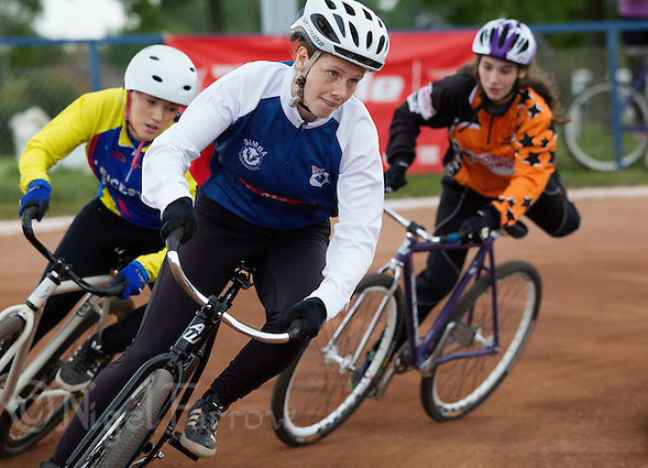13 SEP 2014 - IPSWICH, GBR - Lauren Jacobs (centre) of Ipswich leads Michelle Whitehead (left) of Leicester Monarchs and Ellie Sullivan from Sheffield Stars during a heat at the 2014 British Women's Club Cycle Speedway Championships at Whitton Sports & Community Centre in Ipswich, Great Britain (PHOTO COPYRIGHT © 2014 NIGEL FARROW, ALL RIGHTS RESERVED) (NIGEL FARROW/COPYRIGHT © 2014 NIGEL FARROW : www.nigelfarrow.com)