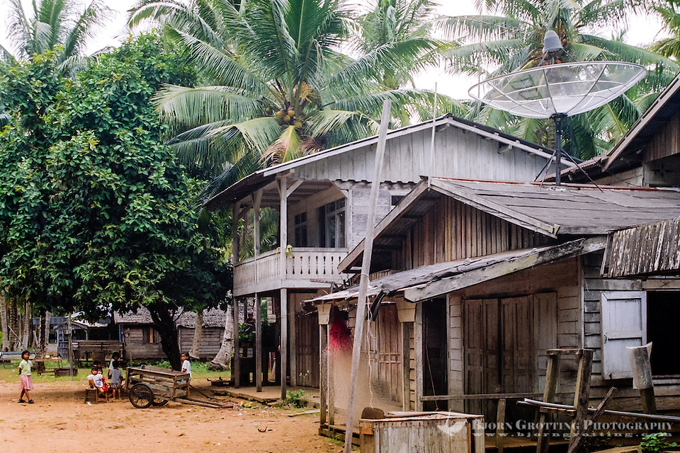Kalimantan, Tanjung Datu. Small village close to the Malaysian border. Even here, far from nearest civilization, a television satellite dish is found on top of a roof. (Bjorn Grotting)