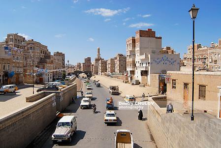SANAA, YEMEN - SEPTEMBER 09, 2006: Unidentified people walk by the street of Sanaa city in Sanaa, Yemen. The old city of Sanaa is a UNESCO World heritage site. (Dmitry Chulov)