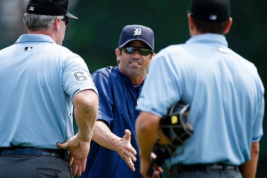Aug 9, 2015; Detroit, MI, USA; Detroit Tigers manager Brad Ausmus (7) argues a call with umpires Ted Barrett (left) and Ben May (right) in the first inning against the Boston Red Sox at Comerica Park. Mandatory Credit: Rick Osentoski-USA TODAY Sports (Rick Osentoski/Rick Osentoski-USA TODAY Sports)
