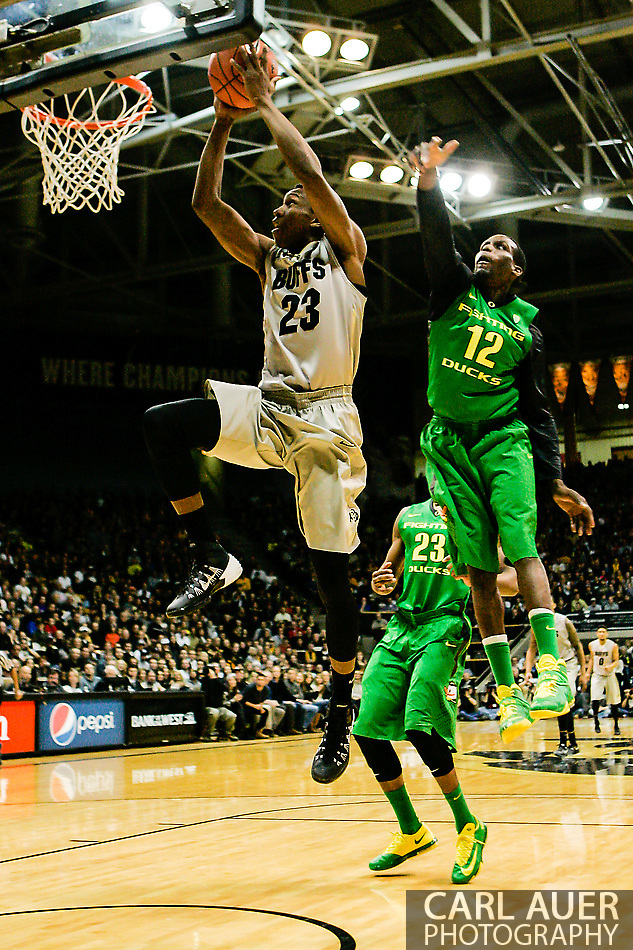 January 5th, 2014:  Colorado Buffaloes freshman guard Jaron Hopkins (23) flies to the hoop for a lay up past Oregon Ducks redshirt senior guard Jason Calliste (12) in first half action of the NCAA Basketball game between the Oregon Ducks and the University of Colorado Buffaloes at the Coors Events Center in Boulder, Colorado (Carl Auer/ZUMAPRESS.com)