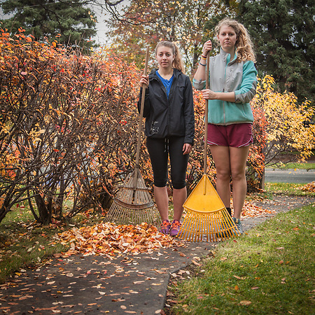 Kayla Jackson and Holly Furman rake leaves, Anchorage (Clark James Mishler)