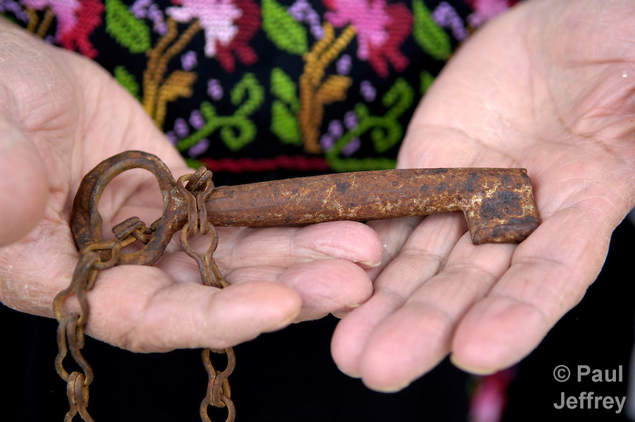 Nathmeya Abdel Fattah, a woman in the Daheisheh Refugee Camp in Bethlehem, holds the key to her home, which she lost almost 60 years ago when she was displaced by the establishment of the state of Israel..