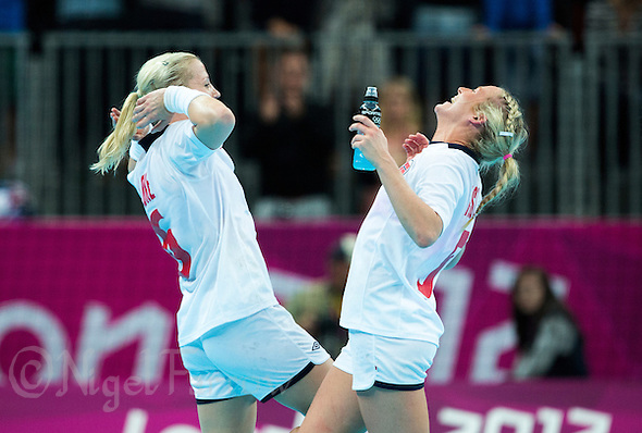 11 AUG 2012 - LONDON, GBR - Heidi Løke (NOR) (left) and Ida Alstad (NOR) (right) of Norway celebrate winning the women's London 2012 Olympic Games handball final against Montenegro at the Basketball Arena in the Olympic Park, in Stratford, London, Great Britain (PHOTO (C) 2012 NIGEL FARROW) (NIGEL FARROW/(C) 2012 NIGEL FARROW)