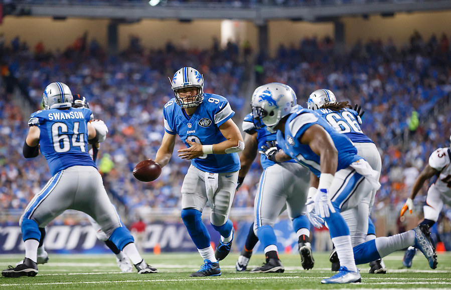 Detroit Lions quarterback Matthew Stafford (9) gets set to handoff against the Denver Broncos during an NFL football game at Ford Field in Detroit, Sunday, Sept. 27, 2015. (AP Photo/Rick Osentoski) (Rick Osentoski/AP)