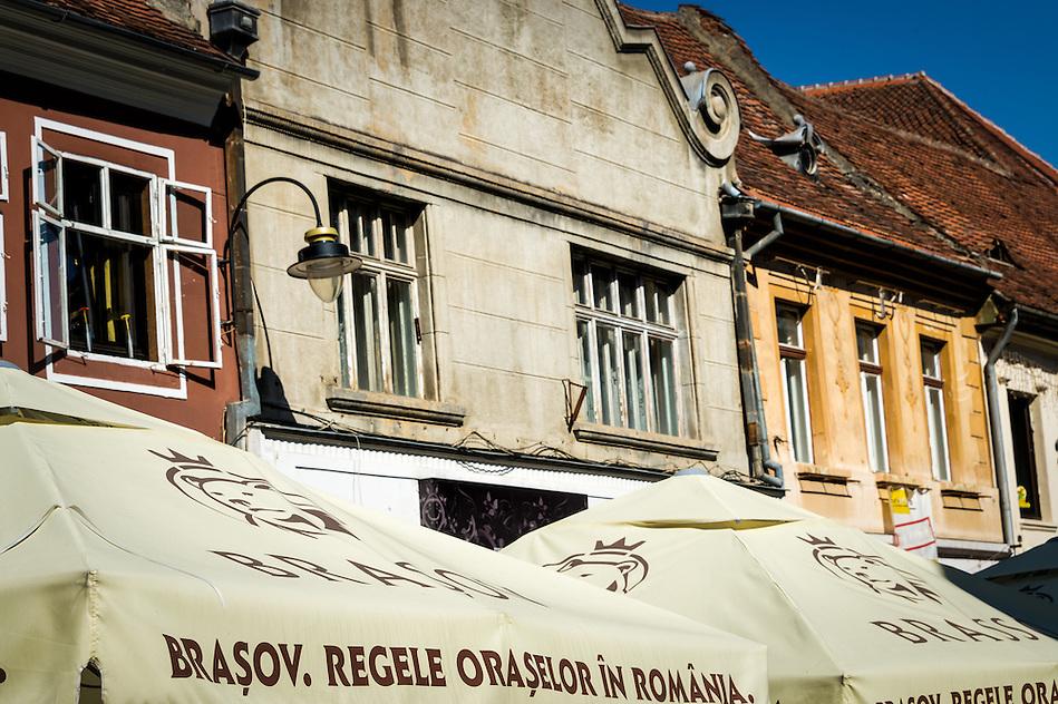 View of typical facades of historic buildings at the pedestrian Strada Replubicii street  in Brasov, Romania (Daniel Korzeniewski)