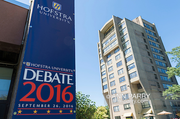 Hempstead, New York, USA. September 13, 2016. Hofstra University Debate 2016 banner - tall vertical in patriotic red white and blue - is one of many displayed on the campus of Hofstra University, which will host the first Presidential Debate, between H.R. Clinton and D. J. Trump, scheduled for later that month on September 26. A high-rise residence hall is at right, also in North Campus. Hofstra is first university ever selected for 3 consecutive U.S. presidential debates. (Ann Parry/Ann Parry, ann-parry.com)