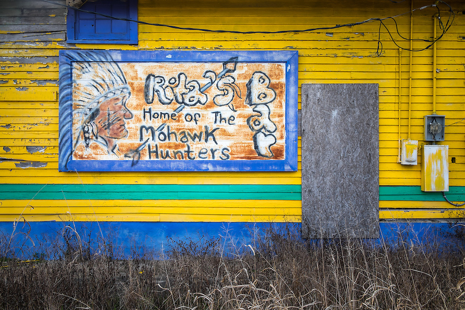 NEW ORLEANS - CIRCA FEBRUARY 2014: View of a of the side wall of an abandoned store in Algiers Point, a popular community within the city of New Orleans in Louisiana. (Daniel Korzeniewski)