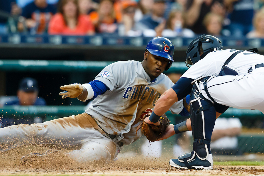 Jun 9, 2015; Detroit, MI, USA; Chicago Cubs right fielder Junior Lake (21) is tagged out at home by Detroit Tigers catcher James McCann (34) in the fifth inning at Comerica Park. Mandatory Credit: Rick Osentoski-USA TODAY Sports (Rick Osentoski/Rick Osentoski-USA TODAY Sports)