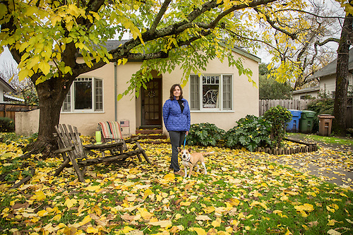 """Calistoga Roastery co-owner Eva King with her foster dog, Daisy, in front of her home on Third Street.  """"I want to paint my house but, for the life of me, I can not pick a color...this has been going on for years.  I've painted the back of the house three times."""" (Clark James Mishler)"""