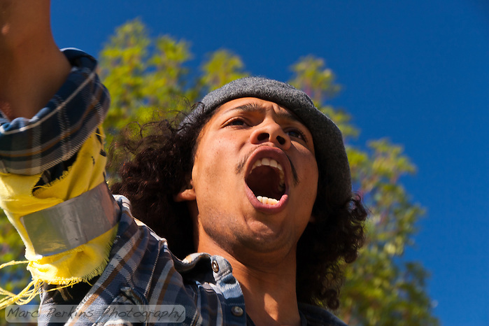 Dew-b Outlaw takes part in a chant during the Occupy Orange County, Irvine march on Saturday November 5. (Marc C. Perkins)
