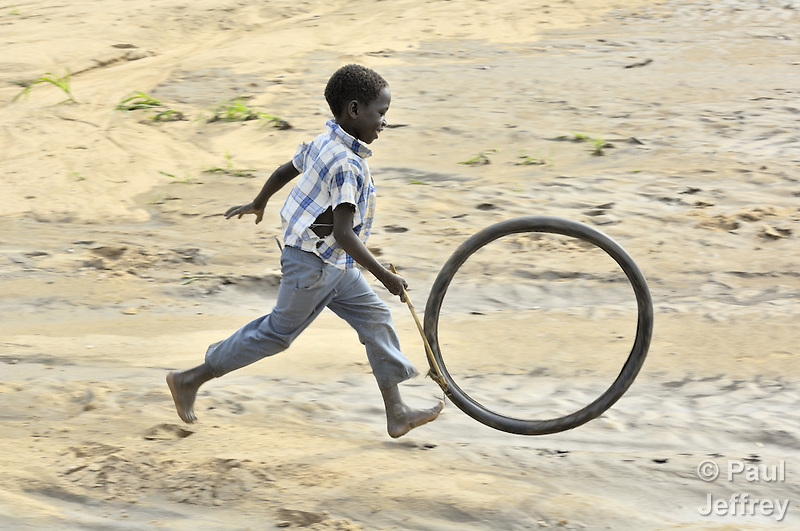 A boy at play in a camp for internally displaced people outside Um Labassa in Sudan's Darfur region. (Paul Jeffrey)