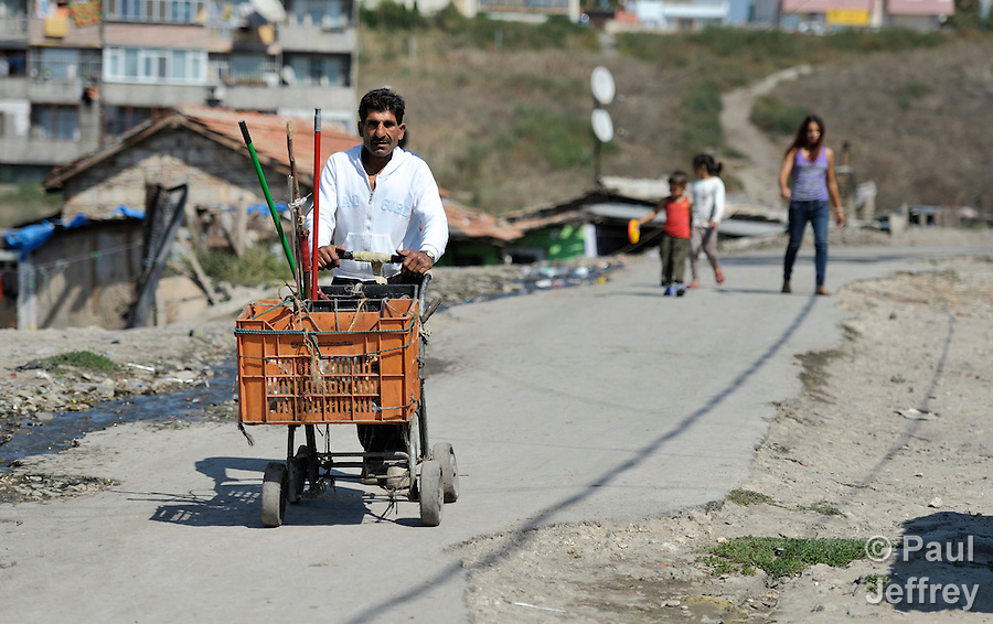 Demir Sandev is a Turkish-speaking Roma man who recycles scrap for a living, and here he pushes the cart he uses for his work through the Maxsuda neighborhood of Varna, Bulgaria. (Paul Jeffrey)