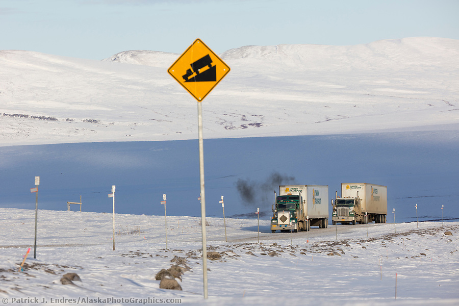 Trucking photos: Trucks travel along the James Dalton Highway near Slope mountain in Arctic, Alaska. (Patrick J Endres / AlaskaPhotoGraphics.com)