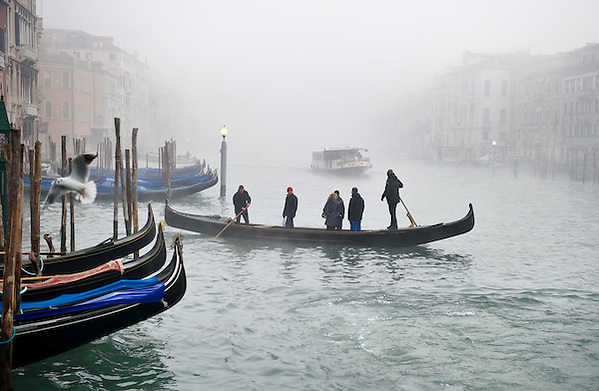 VENICE, ITALY - JANUARY 17: Peak time on the Grand Canal, e waterbus and a gondola ferry cross each other as thick fog shrouds the city on January 17, 2012 in Venice, Italy. Venice woke up this morning under a heavy blanket of fog adding to the atmosphere of the city...HOW TO LICENCE THIS PICTURE: please contact us via e-mail at sales@xianpix.com or call our office London   +44 (0)207 1939846 for prices and terms of copyright. First Use Only ,Editorial Use Only, All repros payable, No Archiving.© MARCO SECCHI (Marco Secchi)