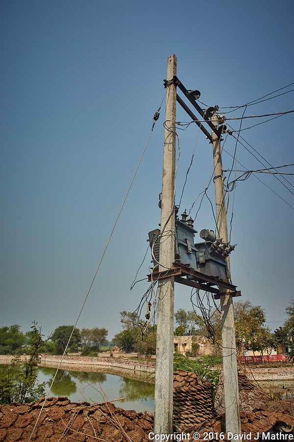 Power Lines and Cow Pies in a Village Near Bharatpur, India. Image taken with a Nikon 1 V3 camera and 10-30 mm VR lens (ISO 200, 11.6 mm, f/5.6, 1/2000 sec) (David J Mathre)