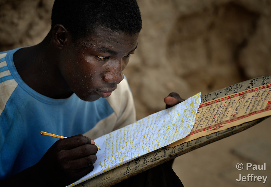 A boy copies Koranic verses in a Muslim school in Timbuktu, the northern Mali city that was seized by Islamist fighters in 2012 and then liberated by French and Malian soldiers in early 2013. (Paul Jeffrey)