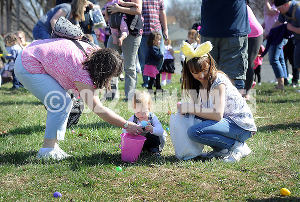 FAIRLESS HILLS, PA - APRIL 12:  A young girls finds and Easter egg with some help from family during the YMCA Easter Egg Hunt April 12, 2014 in Fairless Hills Pennsylvania. (Photo by William Thomas Cain/Cain Images) (William Thomas Cain)