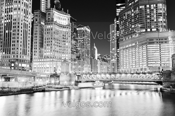 Chicago cityscape at night at Michigan Avenue DuSable Bridge along the Chicago River with 333 North Michigan Avenue building, Crain Communications building (London Guarantee), Leo Burnett building, United Airlines building, Marina City Towers, and Trump International Hotel and Tower. (Paul Velgos)