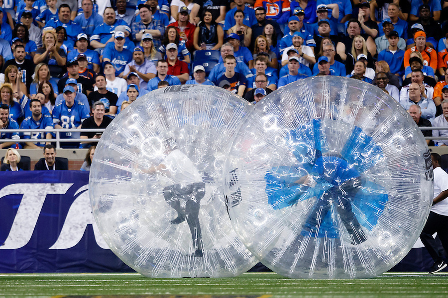 Tim Horton's human ball race during a time out of an NFL football game between the Detroit Lions and the Denver Broncos at Ford Field in Detroit, Sunday, Sept. 27, 2015. (AP Photo/Rick Osentoski) (Rick Osentoski/AP)