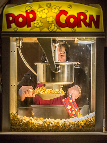 A woman serves popcorn at the Sea View Theatre in the town of Eastsound on Orcas Island, Washington (© Clark James Mishler)