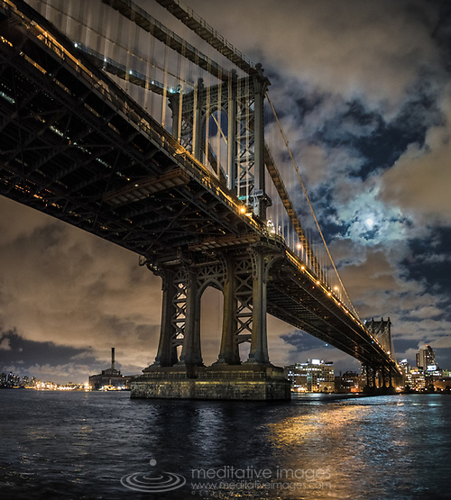 Coming home after a nice bike ride along the east river late one night, I was greeted by this near full moon over the Manhattan Bridge. I was lucky and so grateful to witness such a fresh new look of this impossibly over photographed Manhattan icon. (Michael VanPatten)