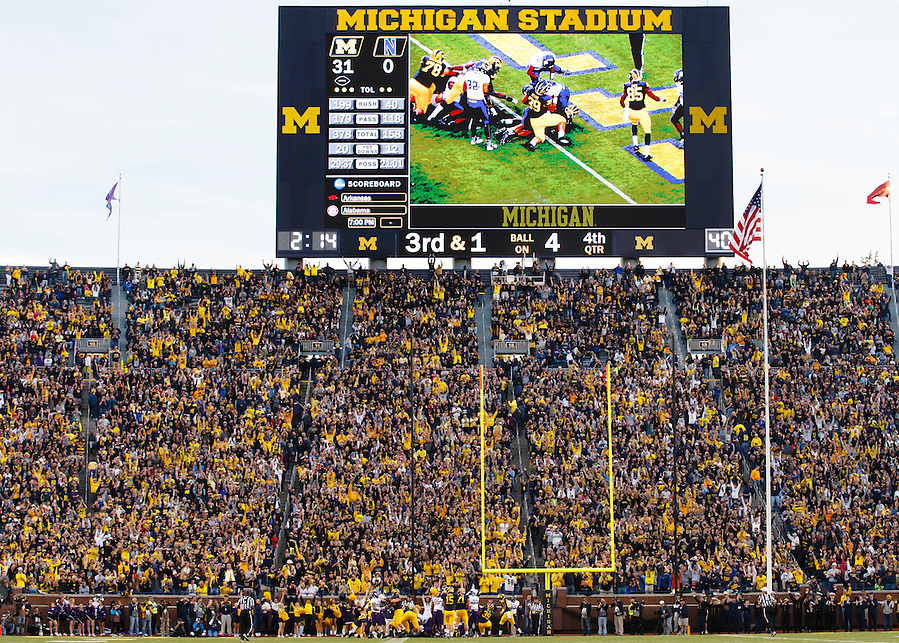 Oct 10, 2015; Ann Arbor, MI, USA; Michigan Wolverines quarterback Jake Rudock (15) indicates a touchdown by running back Derrick Green (27) in the fourth quarter against the Northwestern Wildcats at Michigan Stadium. Mandatory Credit: Rick Osentoski-USA TODAY Sports (Rick Osentoski/Rick Osentoski-USA TODAY Sports)