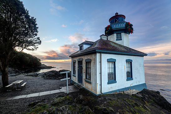 Lime Kiln Lighthouse stands watch over Haro Strait at dawn, Washington (Brad Mitchell)