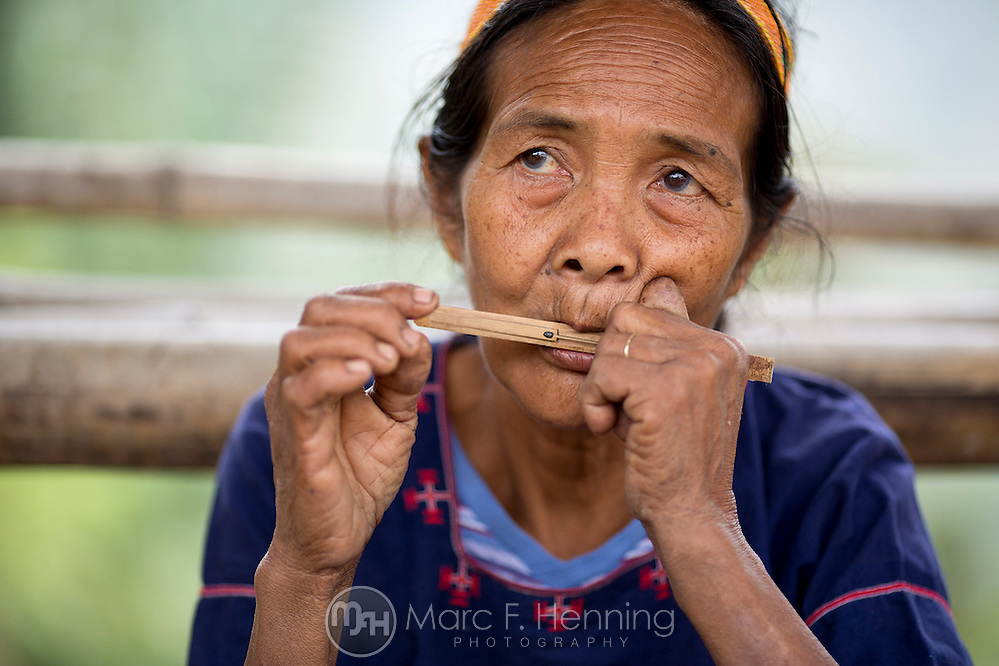 Photo by Marc F. Henning An elder Hanunoo Mangyan woman plays a traditional song on a mouth harp April 16, 2014, during a Mangyan culture demonstration at Panaytayan Village in the mountains above Mansalay, Oriental Mindoro, Philippines. (MARC F. HENNING/MARC F. HENNING PHOTOGRAPHY)
