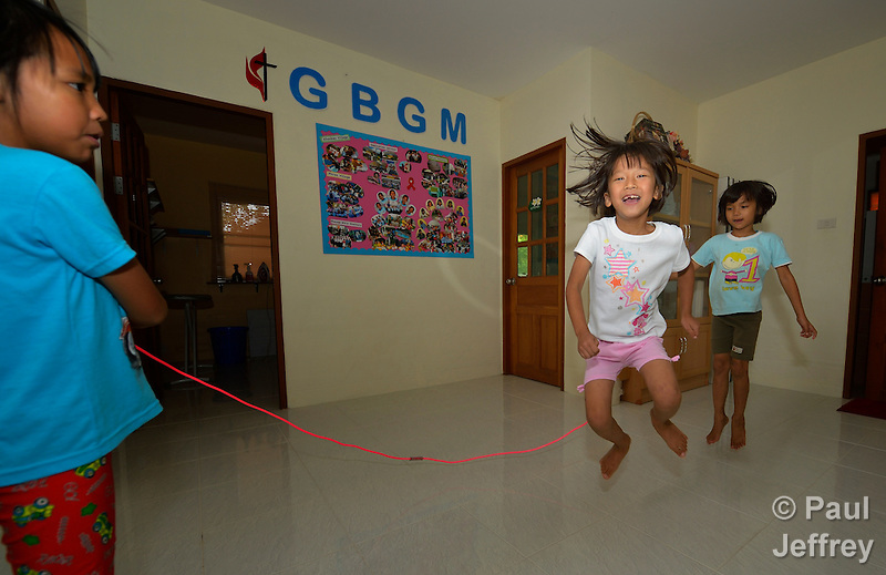 Girls jump rope in an orphanage founded by United Methodist missionaries in Chiang Mai, Thailandi. The girls are orphans, and are all HIV positive. (Paul Jeffrey)