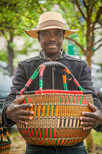 Sia Yambire with his Bolga baskets at the Calistoga Saturday Market (Clark James Mishler)