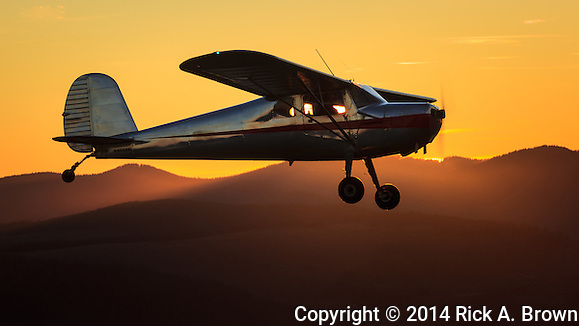 Cessna 140 flying at sunset. (Rick A. Brown)