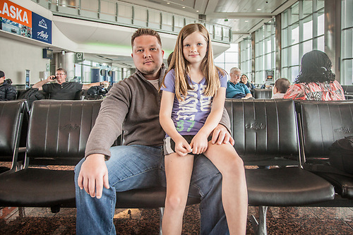 "Leila Kopy (10) with her dad, Chris, at the Anchorage International Airport  ""I want to be a vegetarian when I grow up...I mean a Veterinarian.""  ckopy@live.com (© Clark James Mishler)"