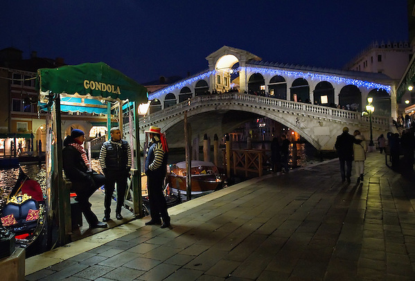 VENICE, ITALY - DECEMBER 08:  Three gondoliers chat near a Christmas decorated Rialto Bridge on December 8, 2011 in Venice, Italy. HOW TO LICENCE THIS PICTURE: please contact us via e-mail at sales@xianpix.com or call our offices in London   +44 (0)207 1939846 for prices and terms of copyright. First Use Only ,Editorial Use Only, All repros payable, No Archiving.© MARCO SECCHI (Marco Secchi)
