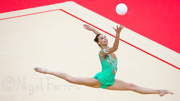 11 AUG 2012 - LONDON, GBR - Joanna Mitrosz (POL) of Poland performs her ball routine during the 2012 London Olympic Games Individual All-Around Rhythmic Gymnastics final at Wembley Arena in London, Great Britain (PHOTO (C) 2012 NIGEL FARROW) (NIGEL FARROW/(C) 2012 NIGEL FARROW)