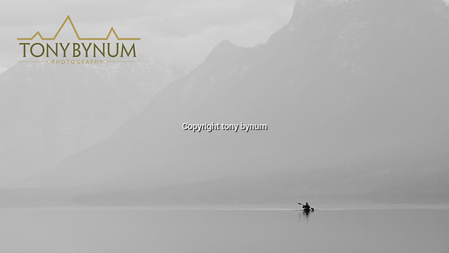 outdoor photography lone kayaker on calm lake glacier national park (Tony Bynum/tonybynum.com)