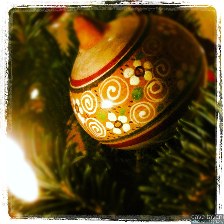 An antique looking Christmas ball is illuminated by a light on our tiny Christmas tree. (Dave Tavani)